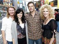 <p>Members of country music band Little Big Town, Karen Fairchild (2nd L), Kimberly Roads (R), Jimi Westbrook (2nd R) and Phillip Sweet (L), pose for a picture in New York October 8, 2007.. REUTERS/Chip East</p>
