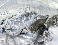 <p>The northern section of Ellesmere island is seen in a 2003 photo from NASA. REUTERS/Handout</p>