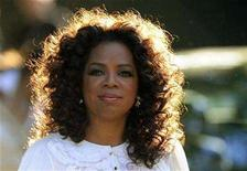 <p>U.S. television presenter Oprah Winfrey arrives for the birthday dinner party of former president of South Africa Nelson Mandela at Hyde Park in London June 25, 2008. REUTERS/Dylan Martinez</p>