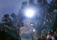 <p>Actress Anne Hathaway poses for photographers during a red carpet event at the Venice Film Festival September 3, 2008. REUTERS/Denis Balibouse</p>