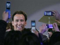 """<p>Actor Nicolas Cage greets fans during a promotional event for the film """"National Treasure: Book of Secrets"""" in Tokyo December 6, 2007. REUTERS/Michael Caronna</p>"""
