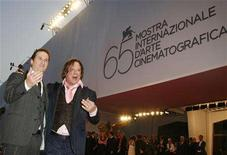 "<p>Actor Mickey Rourke (R) poses with U.S. director Darren Aronofsky during a red carpet event at the Venice Film Festival September 5, 2008. ""The Wrestler"" movie directed by Aronofsky is being shown in the competition at the Venice Film Festival. REUTERS/Denis Balibouse</p>"