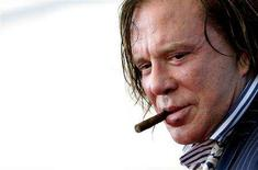 """<p>Mickey Rourke poses during a photocall at Venice Film Festival September 5, 2008. Rourke stars in the movie """"The Wrestler"""" by U.S. director Darren Aronofsky which is shown in competition at the Venice Film Festival. REUTERS/Max Rossi</p>"""