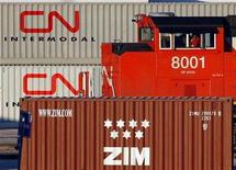 <p>Trains shunt cars at the CN Intermodal yard in Brampton in this February 23, 2007 file photo. CN will ask a U.S. court to force regulators to rule quickly on its planned purchase of the Elgin, Joliet & Eastern Railroad, an executive said on Wednesday. REUTERS/J.P. Moczulski</p>