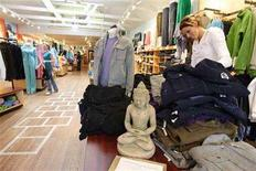 <p>A buddha statue sits at the entrance of Lululemon Athletic, a yoga clothing store, as a women shop with her dog in San Francisco, California, in this March 31, 2006 file photo. REUTERS/Kimberly White/Files</p>