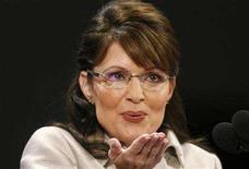 <p>Republican vice presidential candidate Alaska Governor Sarah Palin blows a kiss to her family during her address at the 2008 Republican National Convention in St. Paul, Minnesota September 3, 2008. REUTERS/ Damir Sagolj</p>