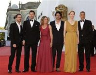 """<p>Ethan Cohen (L to R), Brad Pitt, Frances McDormand, Joel Cohen, Tilda Swinton and George Clooney pose at the red carpet of the Film Festival in Venice August 27, 2008. Pitt, Clooney and Swinton star in Ethan and Joel Coen's movie """"Burn After Reading"""" which is opening this year's Venice Film Festival. REUTERS/Max Rossi</p>"""