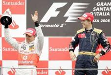 <p>McLaren defende desempenho de Kovalainen na Itália. Heikki Kovalainen (esq.) ao lado do vencedor do GP da Itália, Sebastian Vettel. A McLaren defendeu nesta terça-feira o desempenho do piloto no último final de semana. 14 de setembro. Photo by Alessandro Garofalo</p>