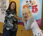 """<p>Dolly Parton (R) composer and lyricist for """"9 to 5: The Musical"""" poses with Patricia Resnick who wrote the book for the musical at a news conference promoting the musical in Los Angeles September 18, 2008. The musical based on the hit 1975 film of the same name features songs by Parton and has its premiere September 20, 2008 in Los Angeles. REUTERS/Fred Prouser</p>"""