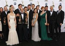 """<p>The producers and cast of """"Mad Men"""" pose after winning for Outstanding Drama Series at the 60th annual Primetime Emmy Awards in Los Angeles September 21, 2008. REUTERS/Mike Blake</p>"""