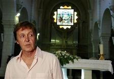 <p>Former Beatles star Paul McCartney visits the Nativity Church in Bethlehem September 24, 2008. REUTERS/Ammar Awad</p>