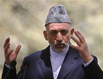 <p>Afghan President Hamid Karzai gestures as he speaks during a news conference at the presidential palace in Kabul, September 11, 2008. REUTERS/Omar Sobhani</p>