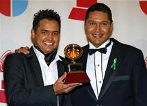 """<p>Jorge Celedon (L) and Jimmy Zambrano of Colombia hold the Grammy for best cumbia/vallenato album for """"Son...Para el Mundo"""" at the 8th annual Latin Grammy Awards in Las Vegas November 8, 2007. REUTERS/Mike Blake</p>"""