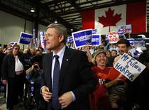 <p>Prime Minister Stephen Harper takes the stage during a campaign rally in Hamilton, Ontario October 7, 2008. REUTERS/Chris Wattie</p>