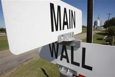 <p>Street signs mark the intersection of Main Street and Wall Street in Windom, Texas October 8, 2008. REUTERS/Jessica Rinaldi</p>