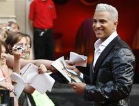 "<p>Make-up artist Jay Manuel from the television show ""America's Next Top Model"" arrives at the Much Music Video Awards in Toronto, Ontario, June 18, 2006. REUTERS/J.P. Moczulski</p>"