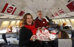 <p>Liberal leader Stephane Dion and his wife Janine Krieber serve cookies on the campaign plane enroute to Vancouver, October 13, 2008. Canadians will head to the polls in a federal election October 14. REUTERS/Shaun Best</p>