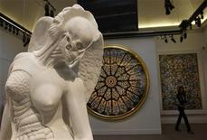 "<p>A visitor walks behind ""Anatomy of an Angel"" by Damien Hirst during a preview of an upcoming auction of his work ""Beautiful Inside My Head Forever"" at Sotheby's in London, September 8, 2008. REUTERS/Suzanne Plunkett</p>"