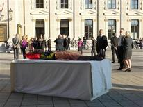 """<p>A woman practises her own funeral as part of an art installation """"The Centre of Attention"""" in Vienna October 18, 2008. REUTERS/Pierre Coinde at The Centre of Attention</p>"""
