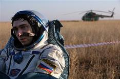<p>Russian cosmonaut Sergei Volkov rests after his Soyuz space capsule landed not far from the the Kazakh town of Arkalyk in northern Kazakhstan October 24, 2008. REUTERS/Dmitry Kostyukov/Pool</p>
