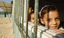 <p>Palestinian students study in a school made of caravans in the village of Mawasi in the southern Gaza Strip October 25, 2008. The village of Mawasi neighbours the city of Rafah in the southern Gaza Strip and overlooks the border with Egypt. Teachers and students at the school blamed Palestinian leaders for failing to make good on promises to build concrete classrooms and said a stifling Israeli blockade imposed on the impoverished territory two years ago made things worse. REUTERS/Ibraheem Abu Mustafa</p>