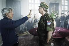 "<p>Italian director Giacomo Battiato (L) sets up a scene with actor Dimitrije Ilic, playing Bosnian Serb General Ratko Mladic, during the filming of ""Resolution 819"" in an undated publicity photo. ""Resolution 819"", a film about the Srebrenica massacre in the last months of Bosnia's 1992-1995 war, won the top prize at the Rome film festival October 31, 2008. A French production directed by Battiato, the film tells the story of a policeman sent by United Nations' highest court to investigate the disappearance of 8,000 men and boys from the Bosnian town after it fell to Bosnian Serb forces. REUTERS/Jerome Prebois/Handout</p>"