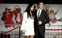"""<p>Cast member Vanessa Hudgens and co-star Zac Efron pose at the premiere of the movie """"High School Musical 3: Senior Year"""" at Galen Center in Los Angeles October 16, 2008. REUTERS/Mario Anzuoni</p>"""