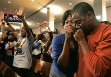 <p>Jackie and Thomas Wilson begin to cry after the announcement that Senator Barack Obama had been elected the first black president as Val Rice celebrates while waiting for the results at Ebenezer Baptist Church in Atlanta, Georgia, November 4, 2008. REUTERS/Tami Chappell</p>