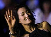 <p>Chinese movie star Gong Li waves as she attends Aimer lingerie trends release S/S 2009 at China Fashion Week in Beijing, November 4, 2008. REUTERS/Jason Lee</p>