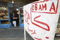 """<p>A resident buys bread in a bakery renamed after U.S. President-elect Barack Obama, in Baghdad November 12, 2008. Hassan Ala'uddin, the bakery owner, said he repainted the sign for his bakery to """"Obama"""", hoping the president-elect will bring change to the U.S and Iraq. REUTERS/Ceerwan Aziz (</p>"""