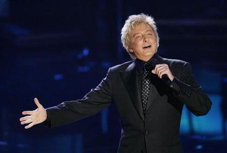 Singer Barry Manilow performs a medley of the songs 'Can't Take My Eyes Off of You' and 'What the World Needs Now Is Love' at the 2006 American Music Awards in this file photo from November 21, 2006 in Los Angeles. REUTERS/Mario Anzuoni