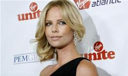 """<p>Actress Charlize Theron poses at the Virgin Unite's """"Rock The Kasbah"""" benefit reception in Hollywood, California October 23, 2008. REUTERS/Mario Anzuoni</p>"""