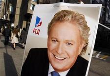 <p>An election poster showing Quebec Premier and Liberal leader Jean Charest is seen in downtown Montreal, November 6, 2008. Quebecers will go to the polls in a provincial election on December 8. REUTERS/Shaun Best</p>