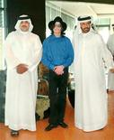 <p>Michael Jackson stands with Dubai-based Arab rally driving champion Mohammed bin Sulayem (R) and the son of the King of Bahrain, Sheikh Abdullah Bin Hamad Al Khalifa, during a private visit to Dubai, August 27, 2005. REUTERS/Total Communications/Handout</p>