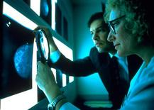 <p>Doctors examine an X-ray in a file photo. Women with a family history of breast cancer but who test negative for two genetic mutations commonly linked to it still have a very high risk of developing the disease, Canadian researchers said on Monday. REUTERS/File</p>
