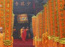 <p>Buddhist abbot Shi Yongxin walks out of the Shaolin Temple during a ceremony in Dengfeng city, in central China's Henan province, July 5, 2007. REUTERS/Donald Chan</p>