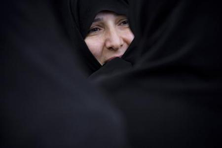 An Iranian woman looks on as she takes part in a rally outside the United Nations office in northern Tehran November 9, 2007. REUTERS/Morteza Nikoubazl