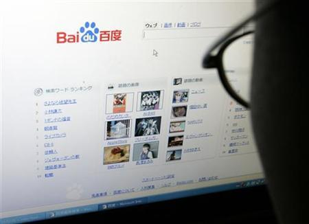 An employee looks at Chinese Web search leader Baidu.com Inc's new Japanese Web search engine as he poses for a photo before a news conference in Tokyo January 23, 2008. REUTERS/Yuriko Nakao