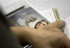 <p>A reporter holds a CD of Spanish tenor Placido Domingo during a news conference at the Vatican November 28, 2008. Domingo presented a new album of songs inspired by poems penned by the late pope John Paul II. REUTERS/Max Rossi</p>