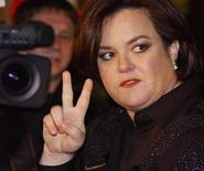 <p>Rosie O'Donnell gives the victory sign in New York, November 13, 2003 . REUTERS/Stephen Chernin SC/HB</p>