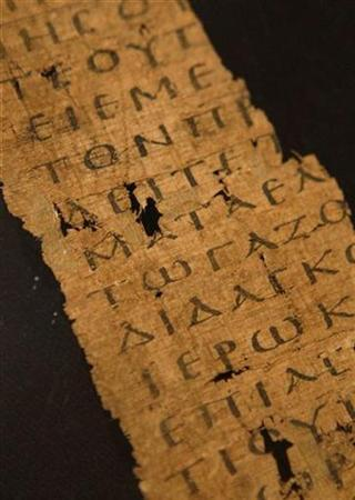 A fragment from a copy of the Gospel of John, circa 200AD, is displayed at Sotheby's auctioneers in London, November 28, 2008. REUTERS/Suzanne Plunkett