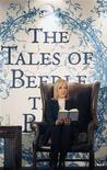 <p>J.K. Rowling reads from her new book 'The Tales of Beedle the Bard' during a tea party to launch it at Parliament Hall in Edinburgh, December 4, 2008. REUTERS/David Cheskin/Pool</p>