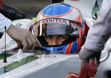 <p>Il pilota Honda Jenson Button. REUTERS/Gustau Nacarino</p>
