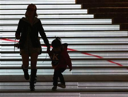 A mother and daughter walk down illuminated stairs at a newly-opened business and amusement complex in Tokyo March 21, 2008. REUTERS/Issei Kato