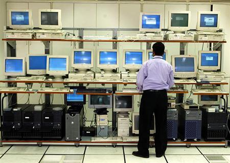 A technician looks at an array of computers in a file photo. REUTERS/File