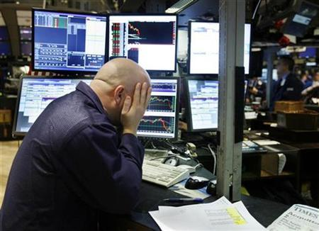 A trader puts his hands on his head, on the floor of the New York Stock Exchange December 5, 2008. REUTERS/Shannon Stapleton