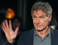 """<p>Actor Harrison Ford waves as he arrives for a screening of his film """"Indiana Jones and the Kingdom of the Crystal Skull"""" in Tokyo, June 5, 2008. REUTERS/Yuriko Nakao</p>"""