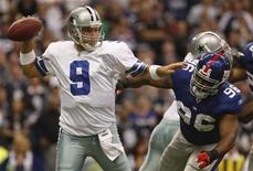 """<p>Dallas Cowboys quarterback Tony Romo passes under pressure from New York Giants' Barry Cofield during the first half of their game in Irving, December 14, 2008. NBC's """"Sunday Night Football"""" was the week's top show with 23.1 million viewers, and was also the most-watched game in the three-year history of the franchise. REUTERS/Jessica Rinaldi</p>"""