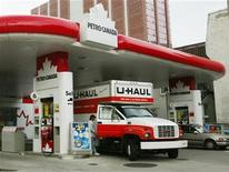 <p>A man gets into a truck outside a Petro Canada gas station in downtown Toronto in this file photo. REUTERS/Andrew Wallace</p>