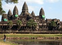<p>A man walks along a lake in Angkor Wat in a file photo. REUTERS/Emma Goh</p>